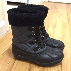 UGG Waterproof Snow/Winter Boot 6 Black and Navy Worn for a season and in great shape!! Very warm, perfect for the snow and cold weather, keeps toes toasty. Lined for comfort and warmth. Black rubber waterproof boot with dark blue lining for style. Clean inside and outside. Authentic UGG. UGG Shoes Winter & Rain Boots