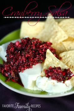 This Cranberry Salsa is another delicious recipe from my mother-in-law and one of my favorite appetizers this time of year.  It is made with fresh ingredients and has an incredible sweet/tangy flavor.  I especially love it because it looks festive- a great appetizer for Christmas/Holiday parties.