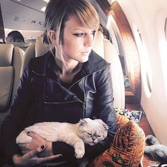 The Celeb Guide to … Being a Frequent Flyer | MAKE YOUR SEAT FEEL LIKE HOME | If you can't be sitting comfy on your couch, you can at least give 27E a homey vibe by, you know, letting your pet sit on your lap like Taylor Swift does. (We dig her BYO throw pillow situation, too.)
