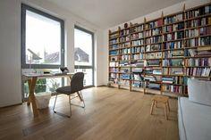 Full-height windows and bookshelf