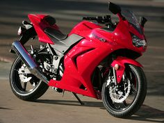 A small and nimble sport motorcycle such as Kawasaki Ninja 250r can ...