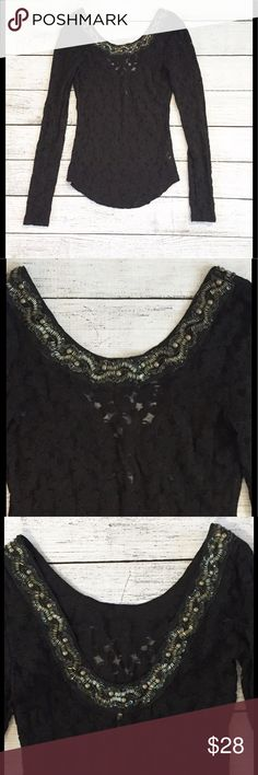"Free People Lace Black Low Back Sexy Beaded Top S Black lace, long sleeved, slips over the head. Beading and sequins all the way around the neckline, which is scooped and lower in back. Super cute! Can be dressed up or down, great condition. Size small. Approximate measurements….14"" straight across under the armpits unstretched and 26"" long. Thanks for looking and have a great day ❤️ Free People Tops"