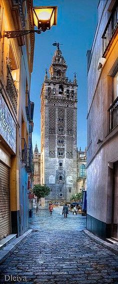 The Giralda is a bell tower of the Seville Cathedral in Seville, Spain.  It was originally built as a minaret during the Moorish period, with a Renaissance style top subsequently added by Spaniards.  A UNESCO World Heritage Site since 1987.  Photo credit: google+/APayton