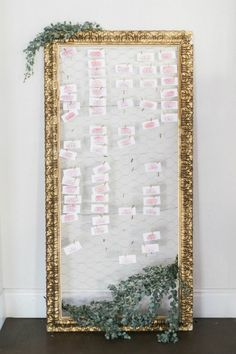 DIY the seating chart for your wedding with this pretty frame and leaf combo. This DIY place card idea gives a romantic, vintage, and outdoor feel to any wedding or event. #placecard