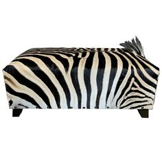 A very nice and decorative ottoman made from a real Burchell zebra skin.This ottoman is from a high quality.Zebras are wild animals so the skin can contain some small scratches. Modern Ottoman, Modern Stools, Handmade Ottomans, African Home Decor, Patchwork Designs, Pouf Ottoman, Cow Hide Rug, Mid Century Modern Furniture, Mid-century Modern