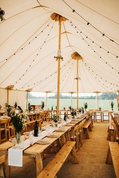 Wooden Tables Benches Chairs Festoon Lighting Whimsical Countryside Sperry Tent Wedding Emilie May Photography #Whimsical #Countryside #Sperry #Tent #Wedding #marquee #summer #farm #wooden #tables #furniture #festoons #lights #benches