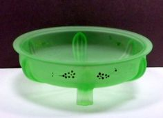 Purchase This Item Here: https://www.etsy.com/listing/223867169/vintage-green-satin-uranium-glass?ref=shop_home_active_1 Offered is a vintage three legged console bowl in a green satin finish with hand painted enamel flower decorations. This bowl was made by L.E. Smith Glass # 1022 in the 1930s. It has wonderful Art Deco lines and glows under a black light indicating that there is uranium in the glass. Dimensions: It's 9 inches in diameter x 3 inches highCondition: It's in good condition…