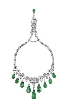 AN ART DECO EMERALD AND DIAMOND NECKLACE, BY VAN CLEEF & ARPELS The baguette-cut and epaulet-shaped diamond neckchain enhanced by pavé-set diamond scalopped links, suspending at the front a fringe of nine graduated drop-shaped emeralds with baguette-cut diamond line surmounts, alternated with rectangular-cut diamond collets, to the pendant clasp with drop-shaped emerald terminal, 1929
