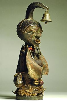 Africa | A nkisi power figure from the Songye people of DR Congo | Wood, horns, teeth, lizard & snake skin, leopard skin, raffia, cloth, beads, metal, copper, seeds | ca. early to mid 20th century