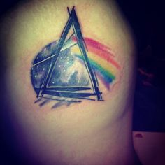 Pink floyd, dark side of the moon rib tattoo