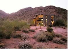 Modern, minimalist custom concrete home surrounded by the beauty of the Arizona desert/San Tan Mountain preserve.