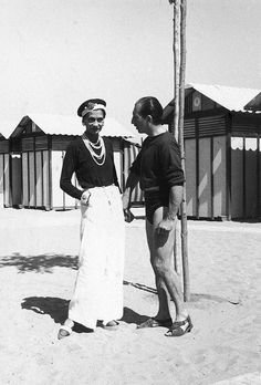 1930    		Gabrielle with the Duke Laurino of Rome on beach at the Lido.