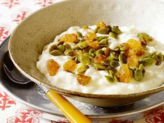 Spoon a mixture of golden raisins and green pumpkin seeds over store-bought rice pudding for a quick-fix dessert.