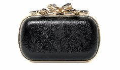 Cannes Red carpet clutches: Nina Ricci - Bijou clutch in patent lambskin with lace embellishment