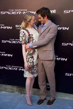 Andrew Garfield drew girlfriend Emma Stone close to him at the Amazing Spider-Man premiere in Madrid in June 2012.