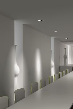 Beautiful white space with the Aplis light by Kreon, a round recessed spotlight system_