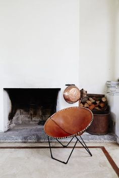 whip stitched leather saucer chair