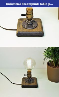 """Industrial Steampunk table pipe lamp with Globe Edison bulb and Weathered wood base. Urban Industrial Craft products are designed by us, handcrafted and assembled in San diego, California ITEM DETAILS: -Measures 5""""W, 8""""H -Cord length 8F -Antique Socket 60 watt max -Globe 40 watt Marconi filament Edison bulb included in purchase -Base is finished in Weathered -All electrical components are UL listed."""