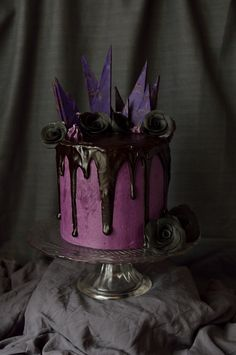Chocolate blackberry elegantly gothic Halloween cake with blackberry swiss…