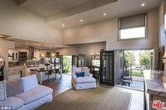Spectacular! A stone fireplace is the focal point of the double-height living room and the huge dining room opens to the gorgeous backyard