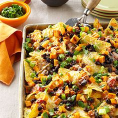 Roasted Pumpkin Nachos - This looks so good, sadly I would have to eat them all by myself.