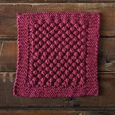 This lovely knit loganberry dishcloth features the bramble stitch which is then surrounded by a border of garter stitches ...
