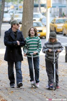 October 25, 2010: Bono and wife Alison Hewson (not pictured) go for a stroll in Central Park with their children Elijah Bob Patricius Guggi Q and John Abraham in New York City.