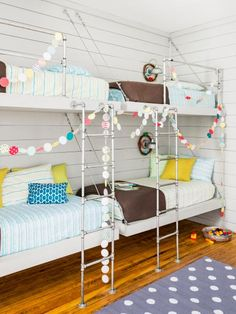 For Drake and Duke's shared room, Joanna designed bunkhouse-style beds, constructed with metal piping and cables. The dotty rug is from The Land of Nod, and the bedding is from Target. Outdoor sconces serve as bedside lights.