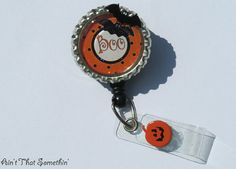 Hey, I found this really awesome Etsy listing at http://www.etsy.com/listing/81556322/halloween-boo-retractable-badge-reel