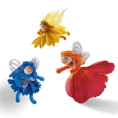 These are freaking adorable. Fairies made with artificial flowers.