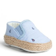 Sweet crib shoes that complete your little boys summer look. Nautical loafer styling in striped cotton with elastic insets at the tongue creates a soft shoe. Embroidered anchors and sailboats. Braided jute trim along the bottom edge. Cotton lining, sock lining and rubber sole. Watch him kick in style.