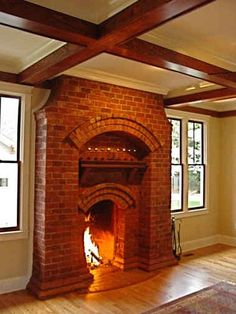 Brick fireplace | Brick and shingle cottage in Georgia | hookedonhouses.net