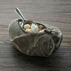 cool-carved-stones-spoon-wood-zipperJapanese artist Hirotoshi Ito does something very special. In his masterful hands, common rocks become strange, unsettling and humorous creations that will make you look twice.