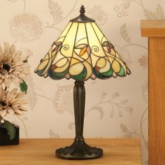 Jamelia Medium Tiffany Table Lamp by Interiors 1900 Sculptured design in organic colours make the Jamelia Large Medium Table Lamp a stunning addition to any room. H: 465 W: 310 D: 310 Bulbs: 1 x 60 E27 Fittings: TB05M Shade: T095SH30