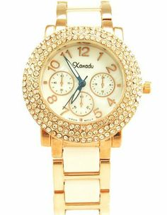 White Ceramic with Swarovski Crystal Rosegold-tone Watch Xanadu. $35.00. Swarovski crystal accented Rose gold-tone bezel. Mother-of-Pearl dial. White ceramic bracelet