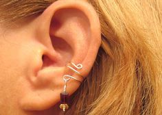 This beautiful ear cuff is handcrafted from sterling silver wire, Garnet and Citrine gemstones.and does not require any piercings.  #jewelry #piercing #gemstone #earcuff #earring #Garnet #Citrine  #ariwolfchild #sterling