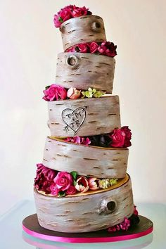My cake will be like this but only 4 teirs, the bark effect will be darker & the flowers in orange & cream.