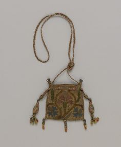 "The elaborately embroidered purses exhibited in this case probably correspond to the sweet bags"" recorded in a number of sixteenth- and seventeenth-century inventories. The purses appear to have been worn around the person and to have carried scented herbs and essences to ward off the evil smells of daily life"