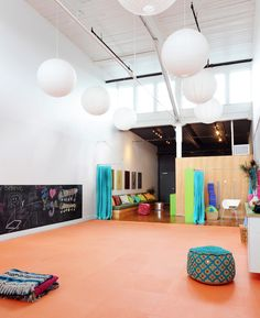 """Ore Studios Interior Design - Om Kids Yoga Center: i like the lantern lights and the high ceilings and it is great for a kids yoga space, colourful, not what i envision for an """"adult"""" yoga studio however"""