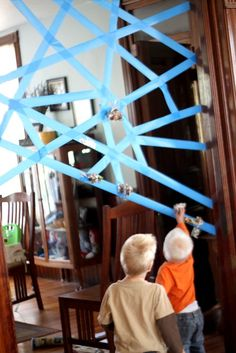 My boys would LOVE this! Sticky spider web - roll up pieces of paper (works on fine motor skills), then throw at the sticky spider web (gross motor skills) AWESOME IDEA!!!!!