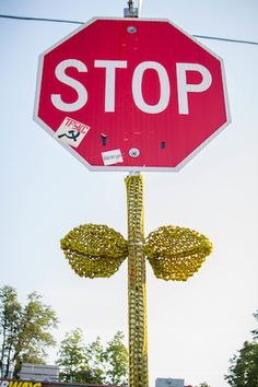100 Stop Sign Flowers in Clairemont - project started by The Knitting Guy and funded by Kick Starter