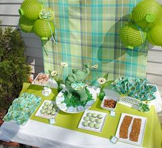 cute use of mini-paper lanterns for a pop of color with plain white serving dishes