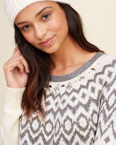 Girls Shine Embellished Fair Isle Pullover | Legging friendly with soft textural stitching, featuring statement pattern, an easy crewneck, ribbed trims and split hem, Easy Fit | HollisterCo.com