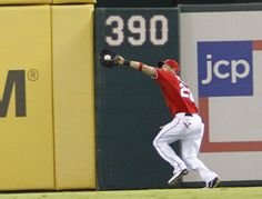 ARLINGTON, TX - MAY 16: Craig Gentry #23 of the Texas Rangers makes a running catch against the Oakland Athletics at Rangers Ballpark in Arlington on May 16, 2012 in Arlington, Texas. (Photo by Rick Yeatts/Getty Images)  game 38