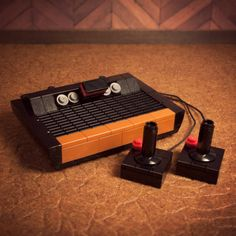 """LEGO Atari with console, controllers, and game cartridge. """"11 Ultra-Realistic Miniature LEGO Builds"""""""