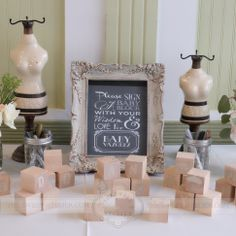 The Sweet Atelier | Vintage Baby Shower | Decorations, Chalkboard like custom graphic design. Wooden Baby Blocks {made by Cristina} for guests to write messages for the new baby.
