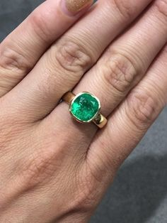 💎 A beautiful 4.17-carat cushion cut emerald set in an 18K yellow gold wide solitaire bezel ring 😍 This incredible piece was sold although we have a similar cushion emerald in stock! What do you think 🤔?? #emeraldring #emerald #emeralds #emeraldcut #cushioncut #jewelrylovers #jewelryaddiction #jewelryinspiration #gemstones #bespokejewellery #ringgoals #showmeyourrings #gemology #alternativeengagementring #alternativebridal #gemstonejewelry #highjewelry #colombianemerald #jewelgram Celebrity Engagement Rings, Band Engagement Ring, Emerald Jewelry, High Jewelry, Colombian Emerald Ring, Gold Models, Bezel Ring, Alternative Engagement Rings, Engagement Inspiration