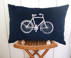 Vintage navy blue velvet pillow with white bicycle.