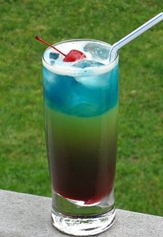 Saturday Slammer: Pineapple Rum, Strawberry Rum, Coconut Rum, Blue Curacao, Orange Juice, Pineapple Juice, Grenadine