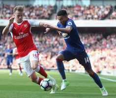 Jesse Lindgaard of Manchester United in action with Rob Holding of Arsenal during the Premier League match between Manchester United and Arsenal at...